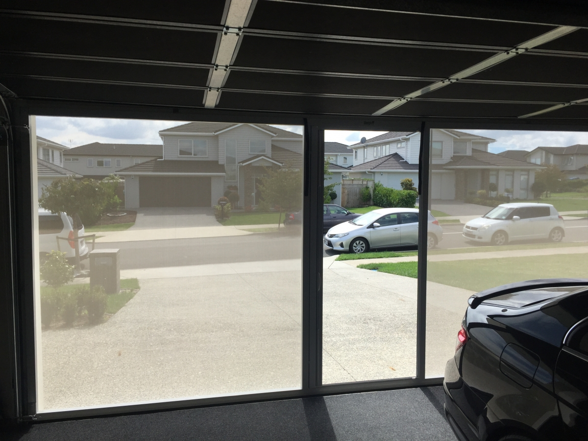 Lifestyle garage screen custom screens ltd the screen features an industry first a ful size retractable centre access door for ease of entry and exit without having to retract the entire system rubansaba